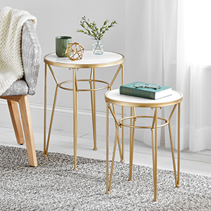 soft brass end tables, book, glasses, plant, coffee cup, decor, chair, gray rug, white sheer curtain