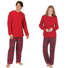 man and woman wearing matching holiday pajamas